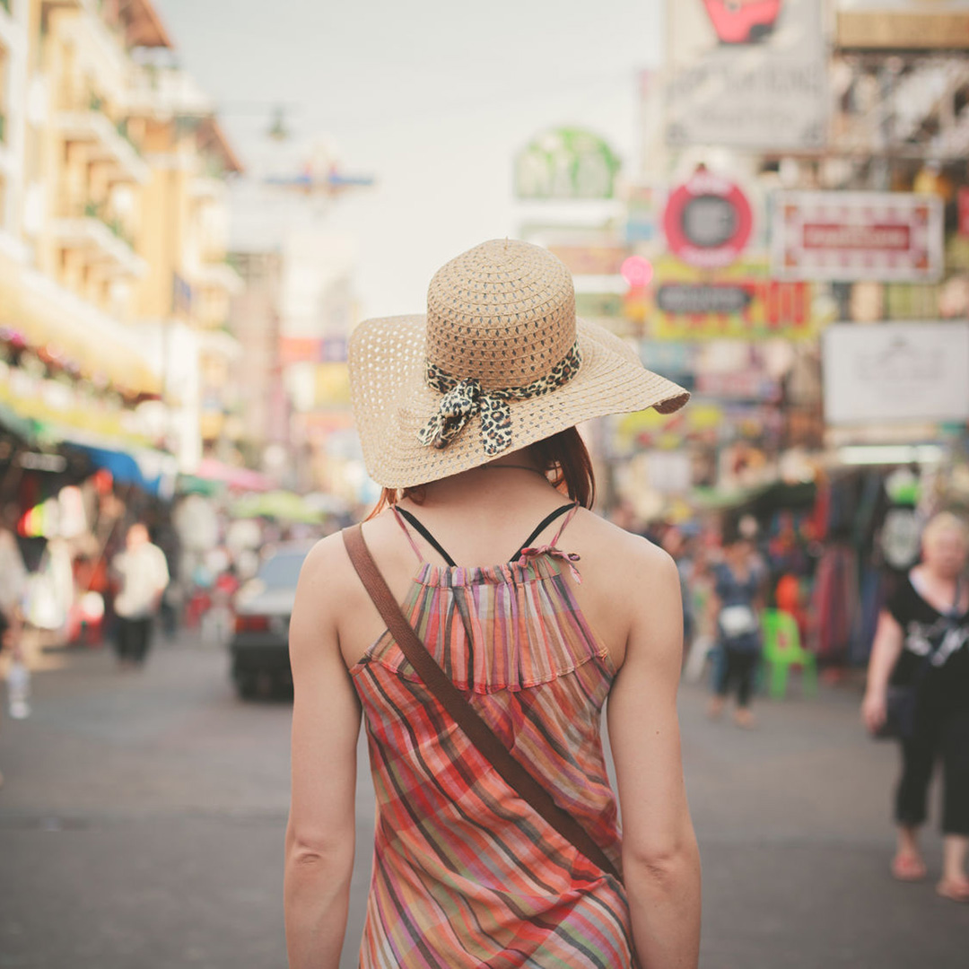 A woman walks down Khao San Street in Bangkok.